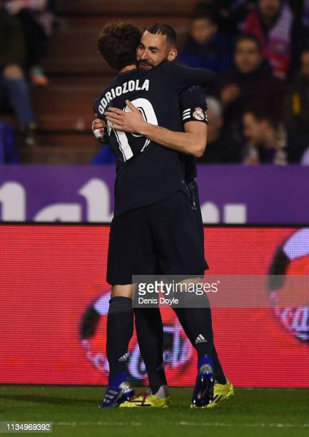 Karim Benzema of Real Madrid celebrates after scoring his team's third goal with Alvaro Odriozola during the La Liga match between Real Valladolid CF...
