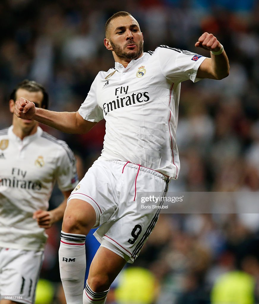 Karim Benzema of Real Madrid celebrates after scoring his team's third goal during the UEFA Champions League Round of 16 second leg match between Real Madrid CF and FC Schalke 04 at Estadio Santiago Bernabeu on March 10, 2015 in Madrid, Spain.
