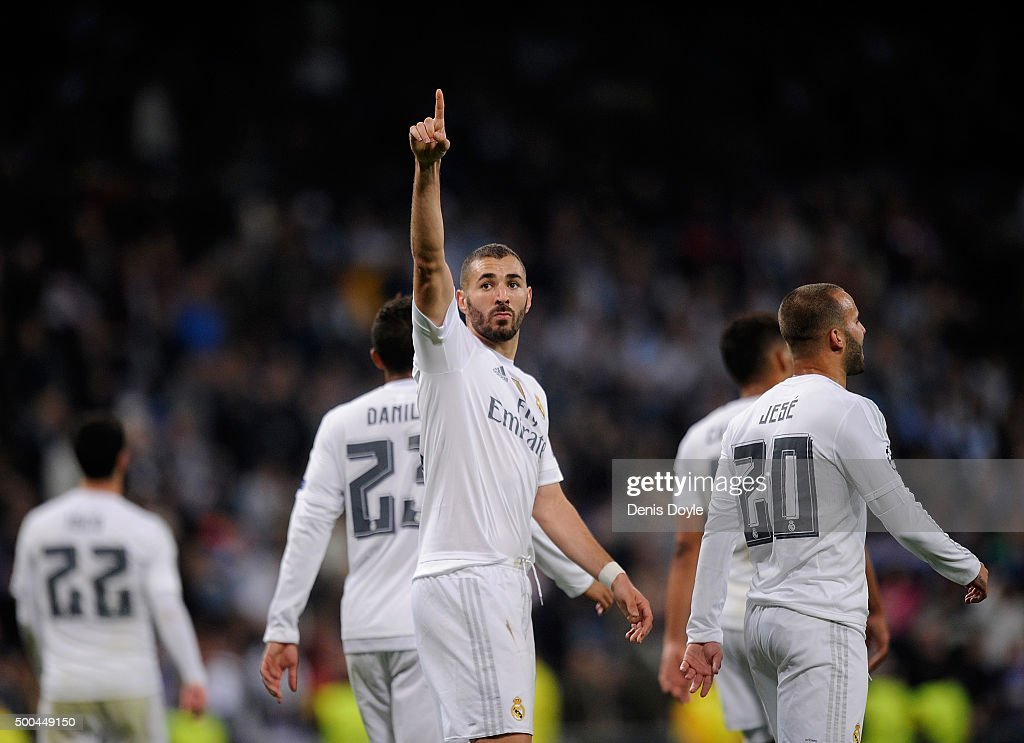 Karim Benzema of Real Madrid celebrates after scoring Real's 8th goal during the UEFA Champions League Group A match between Real Madrid CF and Malmo FF at the Santiago Bernabeu stadium on December 8, 2015 in Madrid, Spain.