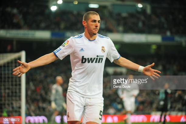 Karim Benzema of Real Madrid celebrates after scoring Real''s first goal during the La Liga match bewteen Real Madrid and Malaga at Estadio Santiago...
