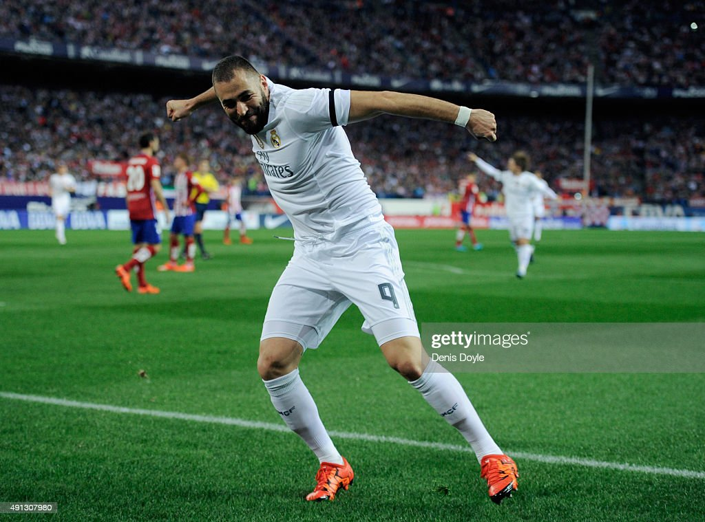 Karim Benzema of Real Madrid celebrates after scoring Real's opening goal during the La Liga match between Club Atletico de Madrid and Real Madrid at Vicente Calderon Stadium on October 4, 2015 in Madrid, Spain.