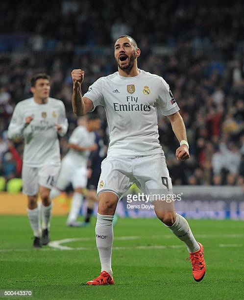 Karim Benzema of Real Madrid celebrates after scoring Real's opening goal during the UEFA Champions League Group A match between Real Madrid CF and...