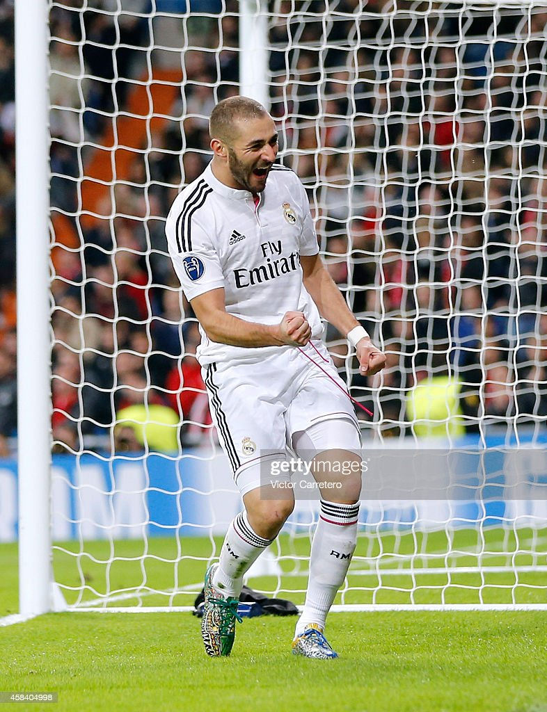 Karim Benzema of Real Madrid celebrates after scoring the opening goal during the UEFA Champions League Group B match between Real Madrid CF and Liverpool on November 4, 2014 in Madrid, Spain.