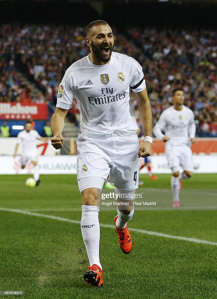 Karim Benzema of Real Madrid celebrates after scoring the opening goal during the La Liga match between Club Atletico de Madrid and Real Madrid CF at Vicente Calderon Stadium on October 4, 2015 in Madrid, Spain.