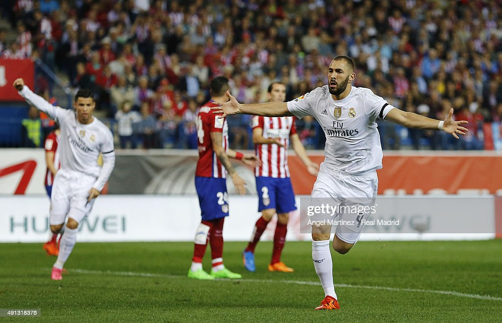 Karim Benzema (R) of Real Madrid celebrates after scoring the opening goal during the La Liga match between Club Atletico de Madrid and Real Madrid CF at Vicente Calderon Stadium on October 4, 2015 in Madrid, Spain.