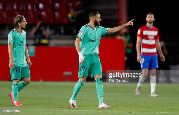 Karim Benzema of Real Madrid celebrates after scoring the teams second goal during the Liga match between Granada CF and Real Madrid CF at on July 13...