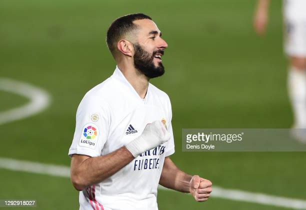 Karim Benzema of Real Madrid celebrates after scoring their sides second goal during the La Liga Santander match between Real Madrid and Granada CF...