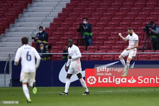 Karim Benzema of Real Madrid celebrates after scoring their side's first goal during the La Liga Santander match between Atletico de Madrid and Real...