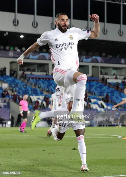 Karim Benzema of Real Madrid celebrates after scoring their side's first goal during the UEFA Champions League Round of 16 match between Real Madrid...