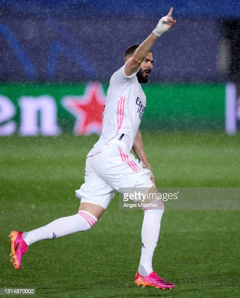 Karim Benzema of Real Madrid celebrates after scoring their side's first goal during the UEFA Champions League Semi Final First Leg match between...