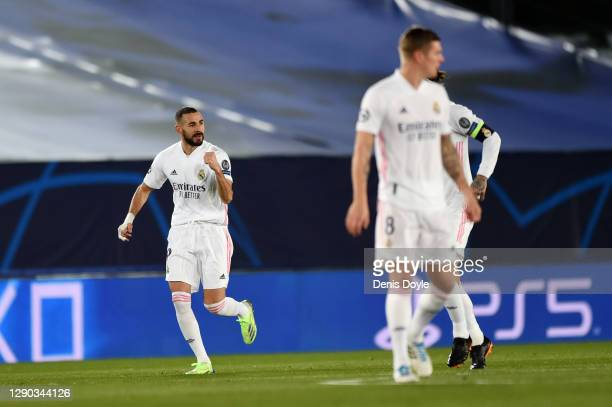 Karim Benzema of Real Madrid celebrates after scoring their team's first goal during the UEFA Champions League Group B stage match between Real...