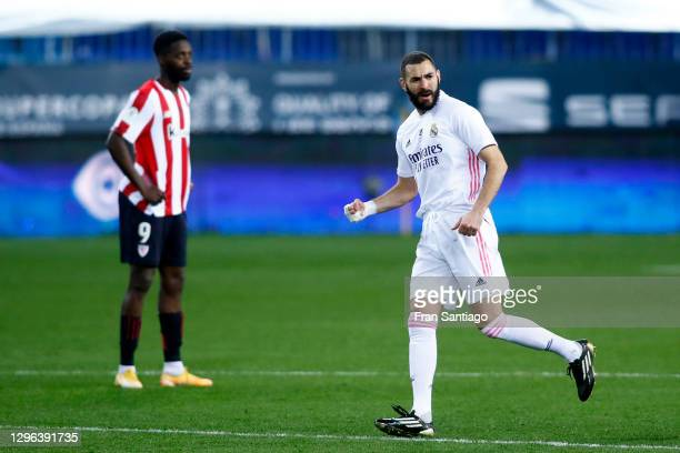 Karim Benzema of Real Madrid celebrates after scoring their team's first goal during the Supercopa de Espana Semi Final match between Real Madrid and...