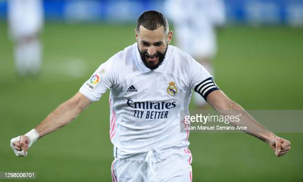 Karim Benzema of Real Madrid celebrates after scoring their team's second goal during the La Liga Santander match between Deportivo Alaves and Real...