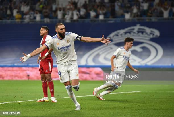 Karim Benzema of Real Madrid celebrates after scoring their team's first goal during the La Liga Santander match between Real Madrid CF and RC Celta...
