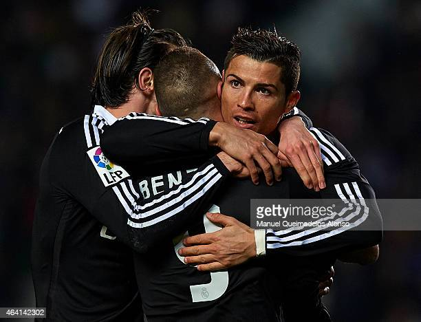 Karim Benzema of Real Madrid celebrates after scoring with his teammates Cristiano Ronaldo and Gareth Bale during the La Liga match between Elche FC...
