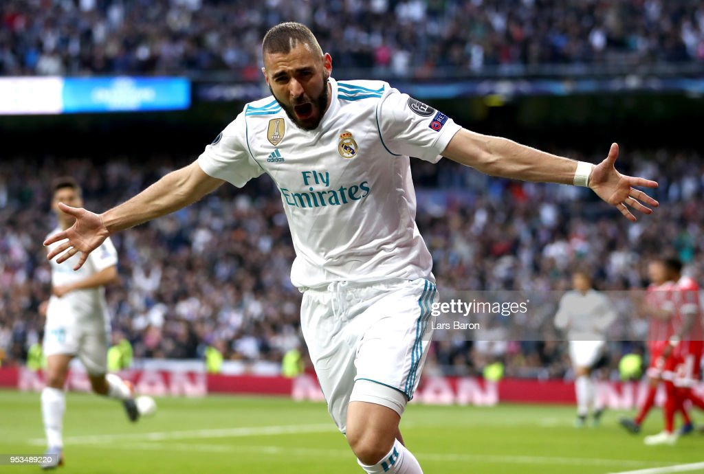 Karim Benzema of Real Madrid celebrates as he scores his sides first goal during the UEFA Champions League Semi Final Second Leg match between Real Madrid and Bayern Muenchen at the Bernabeu on May 1, 2018 in Madrid, Spain.