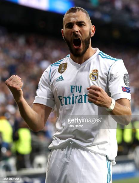 Karim Benzema of Real Madrid celebrates as he scores his sides first goal during the UEFA Champions League Semi Final Second Leg match between Real...
