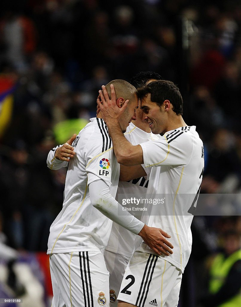 Karim Benzema (L) of Real Madrid celebrates his goal with Alvaro Arbeloa (R) and Cristiano Ronaldo (C) during the La Liga match between Real Madrid and Real Zaragoza at Estadio Santiago Bernabeu on December 19, 2009 in Madrid, Spain.