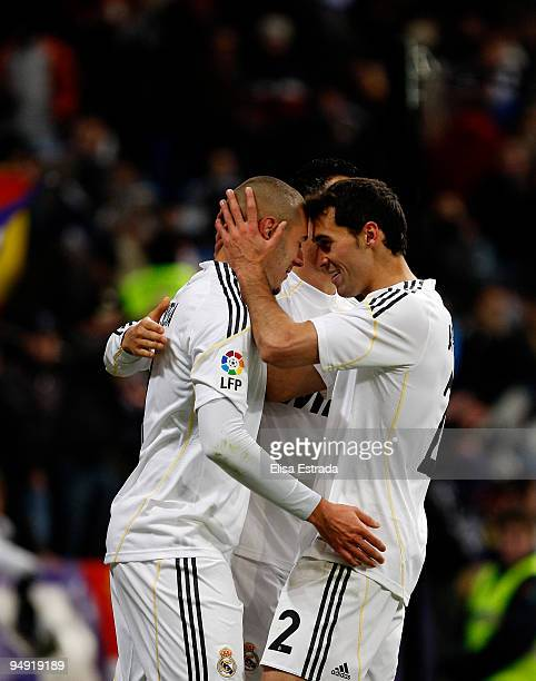 Karim Benzema of Real Madrid celebrates his goal with Alvaro Arbeloa and Cristiano Ronaldo during the La Liga match between Real Madrid and Real...