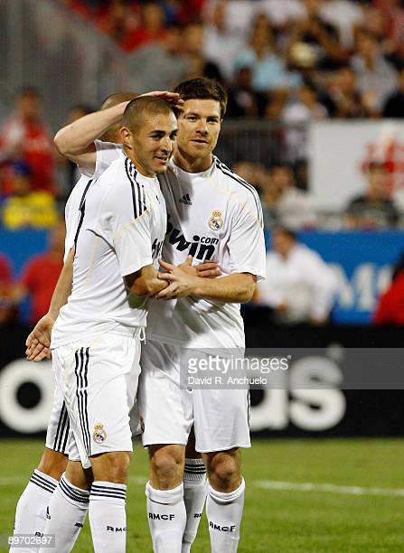Karim Benzema of Real Madrid celebrates his goal with his teammate Xabi Alonso during the match between Toronto FC and Real Madrid at BMO Field on...