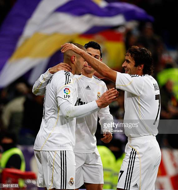 Karim Benzema of Real Madrid celebrates his goal with Raul Gonzalez and Cristiano Ronaldo during the La Liga match between Real Madrid and Real...