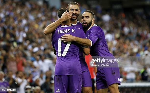 Karim benzema of Real Madrid celebrates his goal with teammates Carvajal and LUcas Vazquez during the Spanish League match between RCD Espanyol vs...