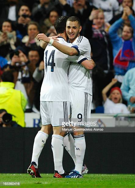 Karim Benzema of Real Madrid celebrates his goal with Xabi Alonso during the UEFA Champions League Quarter Final first leg match between Real Madrid...