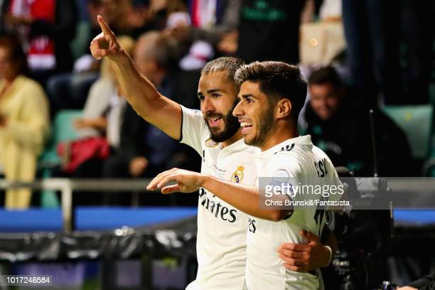 Karim Benzema of Real Madrid celebrates scoring his sides first goal with teammate Marco Asensio during the UEFA Super Cup between Real Madrid and...