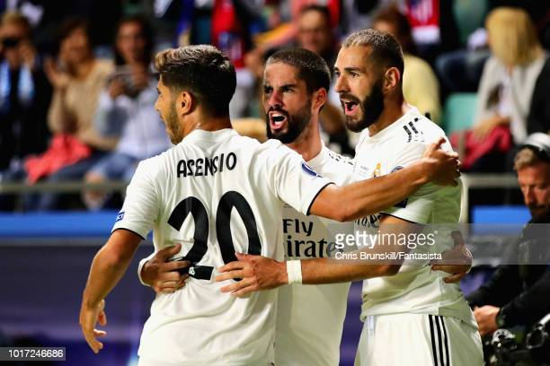 Karim Benzema of Real Madrid celebrates scoring his sides first goal with teammates Marco Asensio and Isco during the UEFA Super Cup between Real...