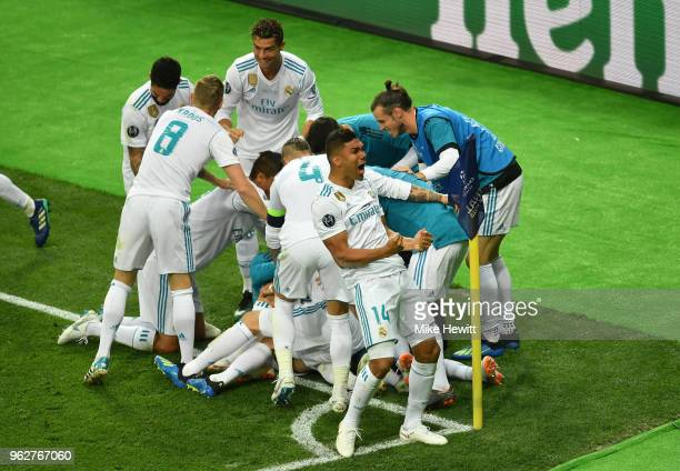 Karim Benzema of Real Madrid celebrates scoring his side's first goal with team mates during the UEFA Champions League Final between Real Madrid and...