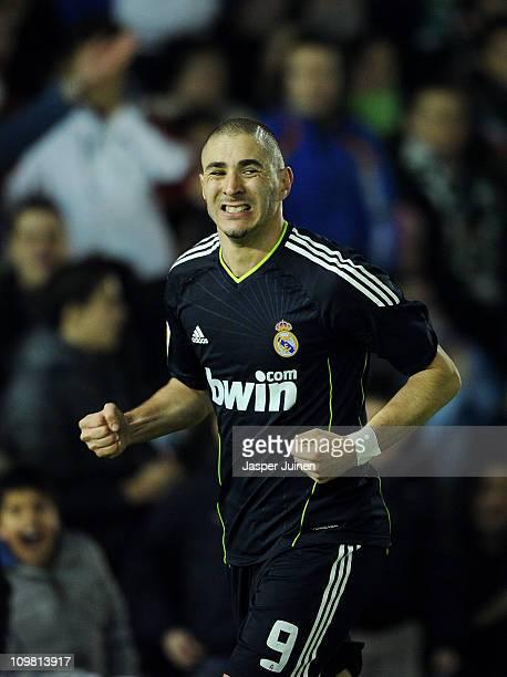 Karim Benzema of Real Madrid celebrates scoring his sides third goal during the la Liga match between Racing Santander and Real Madrid at El...