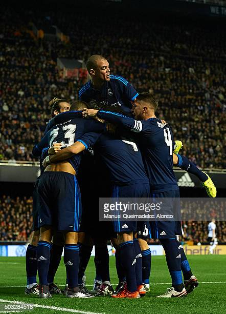 Karim Benzema of Real Madrid celebrates scoring his team's first goal with his teammates during the La Liga match between Valencia CF and Real Madrid...