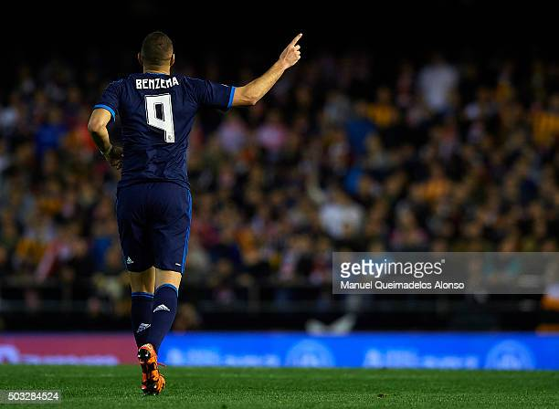 Karim Benzema of Real Madrid celebrates scoring his team's first goal during the La Liga match between Valencia CF and Real Madrid CF at Estadi de...