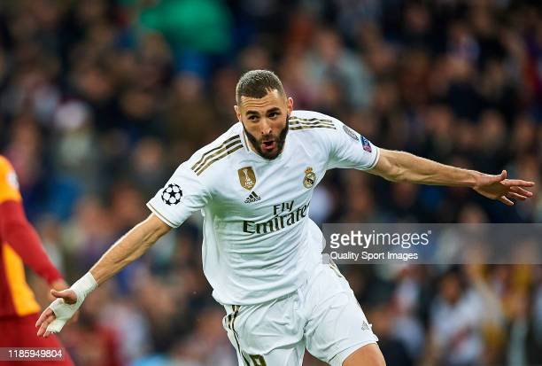 Karim Benzema of Real Madrid celebrates scoring his team's goal during the UEFA Champions League group A match between Real Madrid and Galatasaray at...