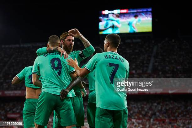 Karim Benzema of Real Madrid celebrates scoring his team's opening goal with team mates during the la Liga match between Sevilla FC and Real Madrid...