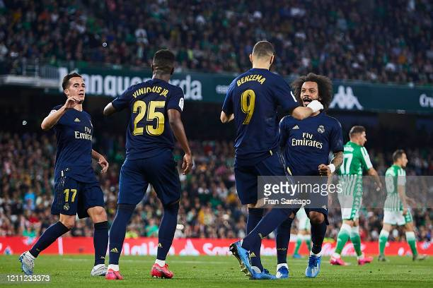 Karim Benzema of Real Madrid celebrates scoring his team's opening goal with team mates during the Liga match between Real Betis Balompie and Real...