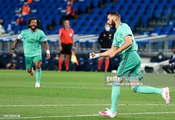 Karim Benzema of Real Madrid celebrates scoring his teams second goal during the Liga match between Real Sociedad and Real Madrid CF at Estadio...