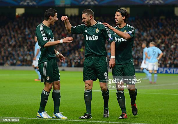 Karim Benzema of Real Madrid celebrates scoring the opening goal with teammates Angel Di Maria and Sami Khedira during the UEFA Champions League...