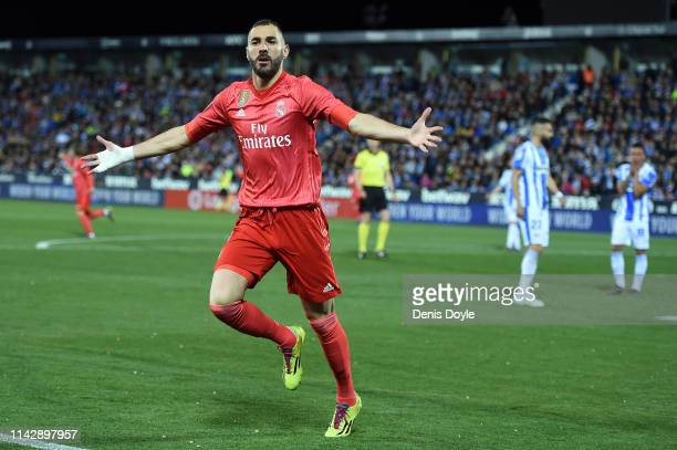 Karim Benzema of Real Madrid celebrates scoring their first goal during the La Liga match between CD Leganes and Real Madrid CF at Estadio Municipal...