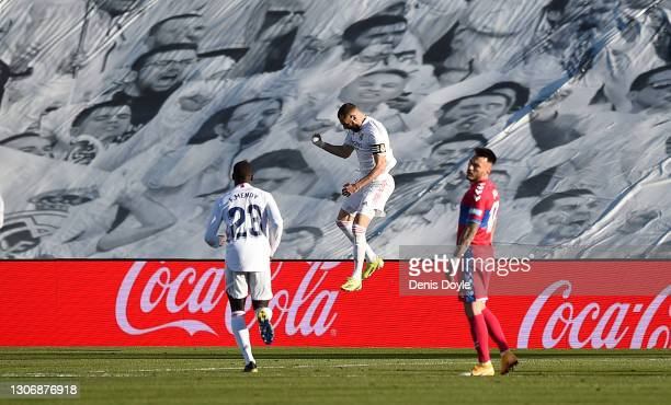 Karim Benzema of Real Madrid celebrates scoring their team's second goal during the La Liga Santander match between Real Madrid and Elche CF at...