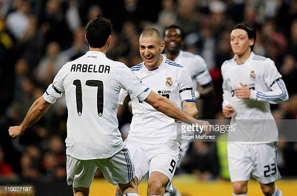 Karim Benzema of Real Madrid celebrates with Alvaro Arbeloa after scoring his side opening goal during the La Liga match between Real Madrid and...