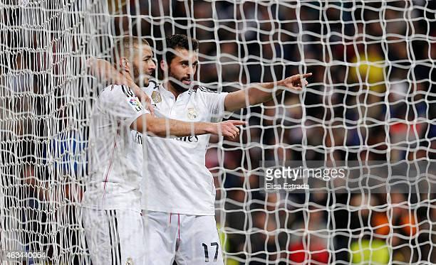 Karim Benzema of Real Madrid celebrates with Alvaro Arbeloa during the La Liga match between Real Madrid CF and RC Deportivo La Coruna at Estadio...