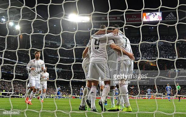 Karim Benzema of Real Madrid celebrates with Cristiano Ronaldo after scoring Real's 2nd goal during the La Liga match between Real Madrid CF and RC...