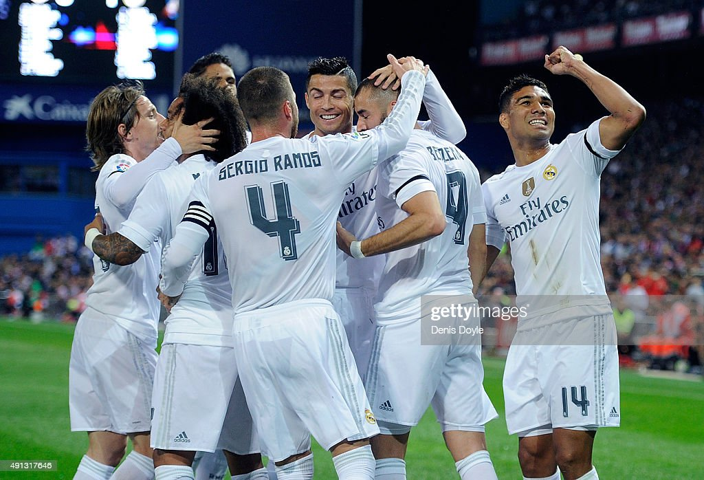 Karim Benzema of Real Madrid celebrates with Cristiano Ronaldo after scoring Real's opening goal during the La Liga match between Club Atletico de Madrid and Real Madrid at Vicente Calderon Stadium on October 4, 2015 in Madrid, Spain.