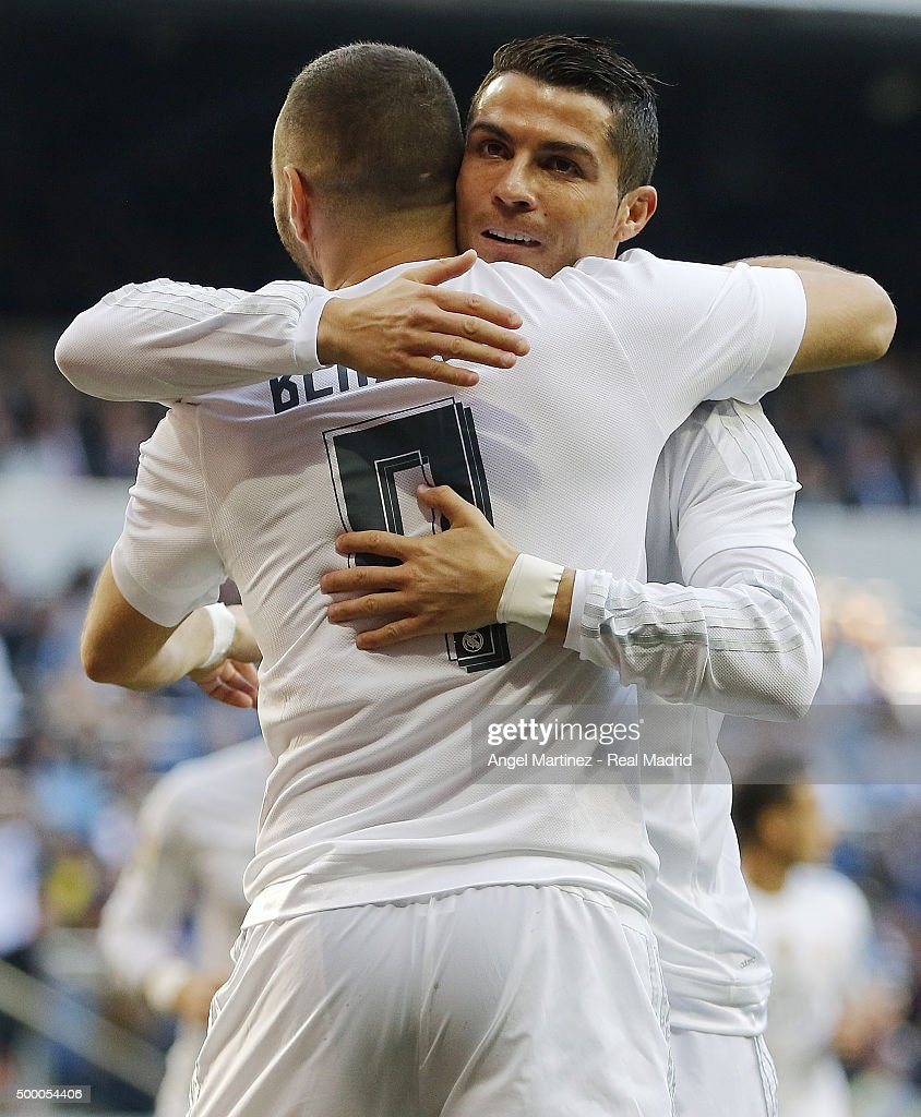 Karim Benzema (L) of Real Madrid celebrates with Cristiano Ronaldo after scoring the opening goal during the La Liga match between Real Madrid CF and Getafe CF at Estadio Santiago Bernabeu on December 5, 2015 in Madrid, Spain.