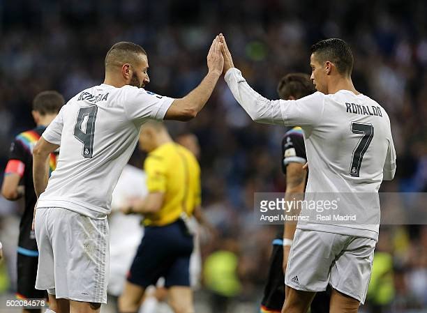 Karim Benzema of Real Madrid celebrates with Cristiano Ronaldo after scoring their team's nineth goal during the La Liga match between Real Madrid CF...