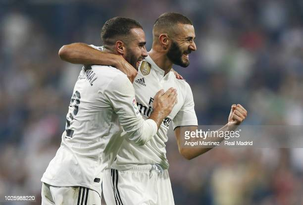 Karim Benzema of Real Madrid celebrates with Dani Carvajal after scoring their team's third goal during the La Liga match between Real Madrid and CD...