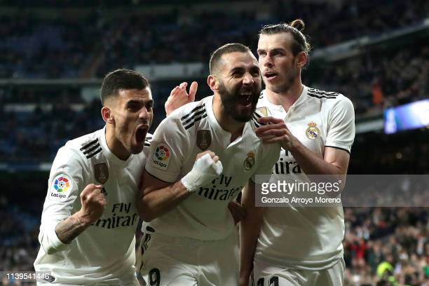 Karim Benzema of Real Madrid celebrates with Dani Ceballos and Gareth Bale after scoring his sides third goal during the La Liga match between Real...