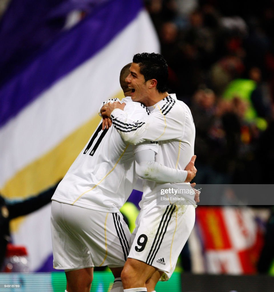 Karim Benzema (L) of Real Madrid celebrates with fellow goalscorer Cristiano Ronaldo after scoring the 6:0 goal during the La Liga match between Real Madrid and Real Zaragoza at Estadio Santiago Bernabeu on December 19, 2009 in Madrid, Spain.