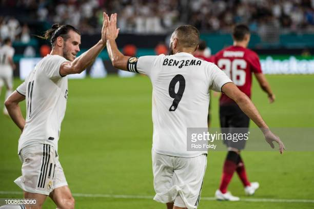 Karim Benzema of Real Madrid celebrates with Gareth Bale after scoring a goal during the first half of the International Champions Cup match against...